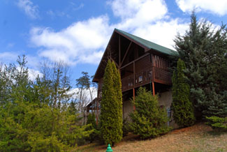 Pigeon Forge Three Bedroom Cabin with a hot tub game tables and internet access