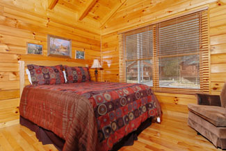 Pigeon Forge Cabin that features a King Size Bed in the Bedroom