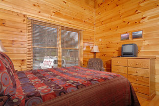 Pigeon Forge Cabin Bedroom that has a recliner-tv-kingsize bed