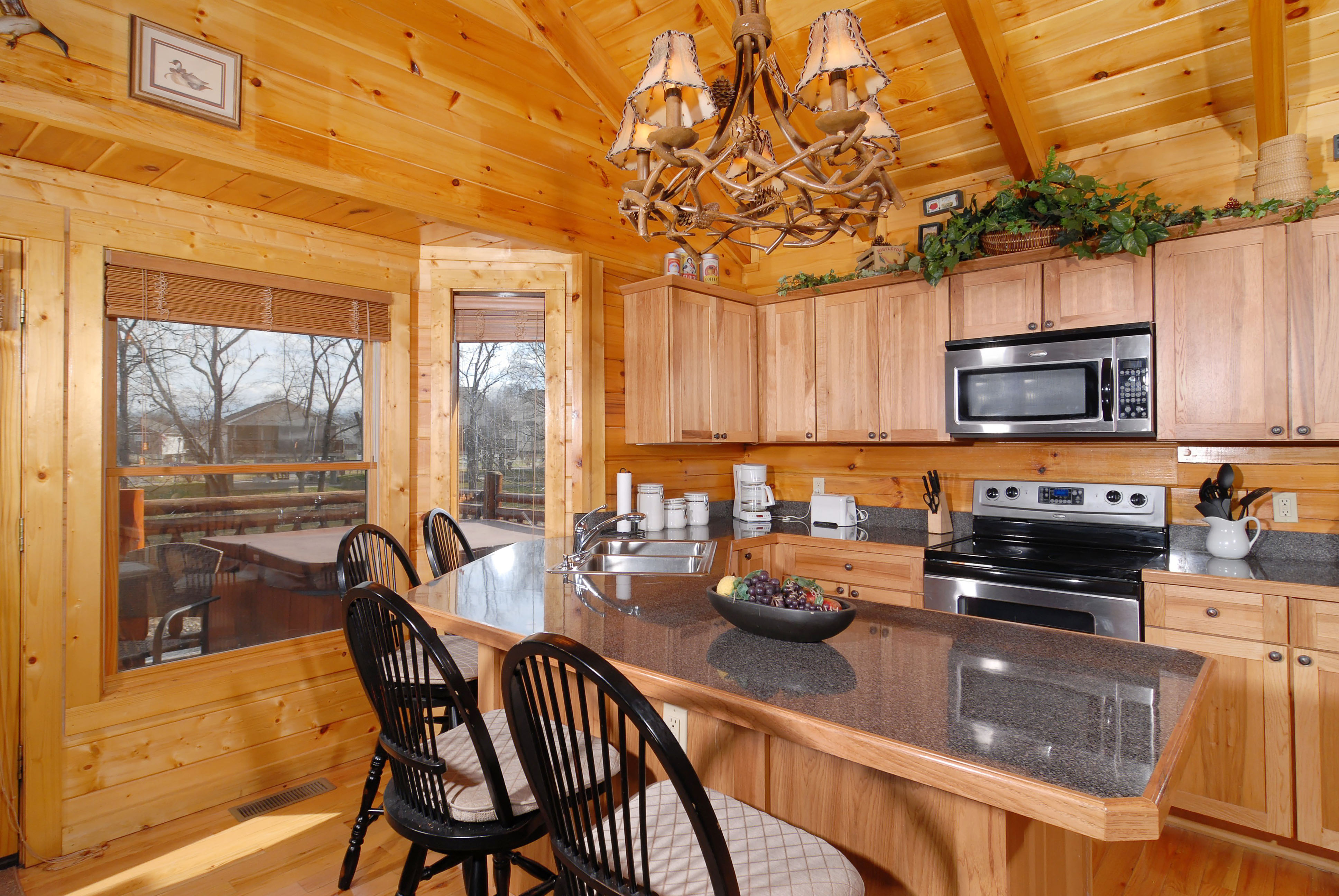Pigeon Forge River Cabin that features a Deluxe Kitchen area overlooking the Little Pigeon River Convenient to Hwy 441