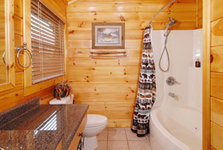 Pigeon Forge River Cabin that features  year round indoor jacuzzi tub with a shower