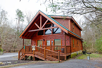 Pigeon Forge Two Bedroom Cabin Rental that is very convenient to the Pigeon Forge Parkway with the Hot Tub, Pool Table, and Internet Access
