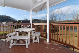 Pigeon Forge Chalet featuring outdoor Covered dinning area Little Pigeon River