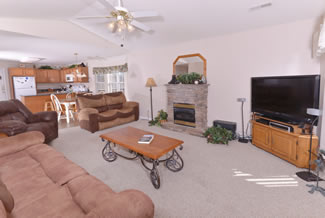 Pigeon Forge Cabin Rental that features livingroom with a flat screen television