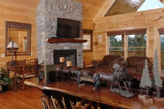Tennessee Vacation Cabin Rental that has a flat screen television and a gas fireplace in the spacious living room area on the main level of the cabin