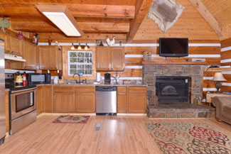 Three Bedroom Cabin Rental that features a large dinning area and also a kitchen that leads into the living room area. Great for holiday events for a larger family