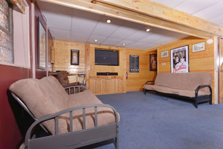 Pigeon Forge Three Bedroom Cabin Rental that Features a Theater System in the Lower Level Area