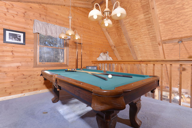 Pigeon Forge Three Bedroom Cabin Rental Featuring a Pool Table in the Upper Level Loft Area