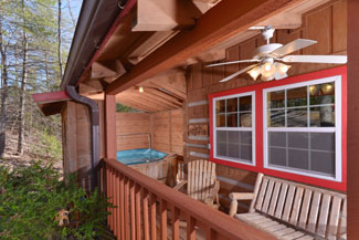 Tennessee Vacation Cabin Rental that features rustic log furniture for the outdoor seating area