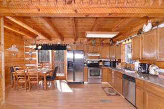 Tennessee Vacation Cabin Rental featuring a large kitchen and dinning area