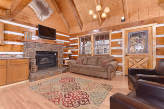 Pigeon Forge Three Bedroom Cabin Rental Livingroom area that is an open floor plan that leads into the kitchen