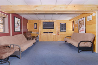 Theater System is Located in the Lower Level of this Affordable Three Bedroom Cabin Rental Convenientely located to the Pigeon Forge Parkway in the Smokies