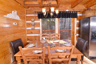 Pigeon Forge Tennessee Cabin Rental that features a great dinning area for the holidays or morning breakfast