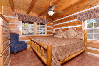 Pigeon Forge Cabin Rental that features a Master Suite that has hardwood floors that is located on the main level