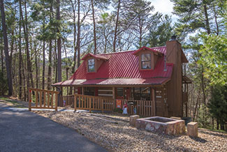 Pigeon Forge Two Bedroom Pet Friendly Cabin Rental that has a multi-game table Hot Tub Outdoor Fireplace
