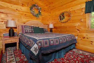 Pigeon Forge Four Bedroom Cabin That features a Big Screen Tv in the bedroom