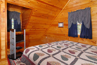 Cabin bedroom that features a television and wood interior
