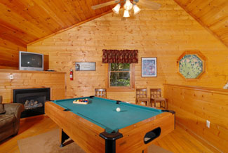 Pigeon Forge Four Bedroom Cabin Featuring A Lofted Game Room with Pool Table, Dart Board, and Fireplace