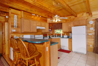 Pigeon Forge Cabin Featuring a Fully Equipped Kitchen with Breakfast Bar Seating