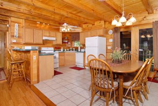 Pigeon Forge Cabin that features a kitchen and seating area