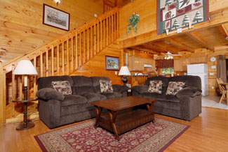 Pigeon Forge Four Bedroom Cabin that features comfortable living room furniture with hard wood floors and a wood interior.