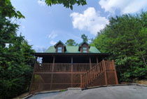 Pigeon Forge Two Bedroom that Can sleep what a 4 bedroom Can Cabin Rental near the main parkway surrounded by woods