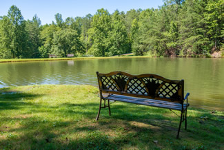 Relax in a Caney Creek Cabin that features an outdoor fishing pond area
