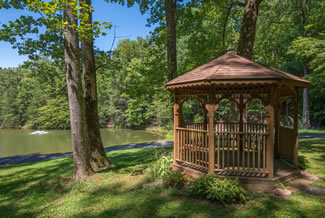 Pigeon Forge Conveneint Caney Creek Cabin Area that features stocked fishing pond and pavilion