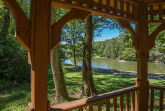 Caney Creek Cabin Area that features a stocked fishing pond and pavilion