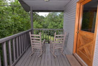 Pigeon Forge Two Bedroom Cabin Rental Rockers on the Scenic Wooded back Porch