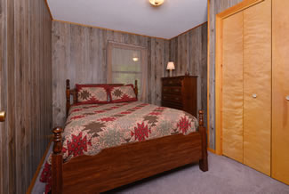 Pigeon Forge Cabin Rental that features a Rustic Cabin Bedroom