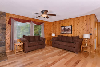 Pigeon Forge Two Bedroom Cabin Rental Rustic Livingroom with a gas fireplace