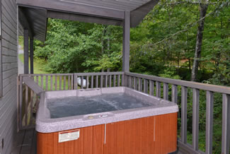 Tennessee Vacation Cabin Rental that features an outdoor hot tub