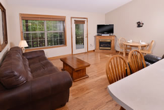 Pigeon Forge Cabin Rental that features a fully equipped kitchen and livingroom area
