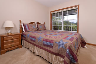 Pigeon Forge Cabin Rental that features a second bedroom with a Queen Size bed
