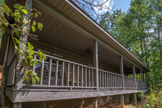 Pigeon Forge Two Bedroom Cabin Rental that features a hot tub and a mountain view