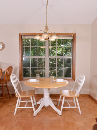 Pigeon Forge Cabin Rental that features a small dinette table with the fully equipped Kitchen