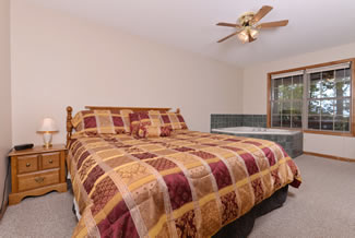 Pigeon Forge One Bedroom Cabin Rental that features a Queen Size Bed in the Master Bedroom