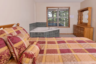 Pigeon Forge Cabin Rental Master Suite Bedroom