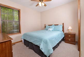 Pigeon Forge Two Bedroom Cabin Rental with a Queen Size Bed in the Bedroom