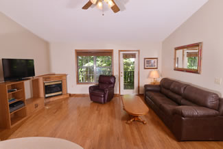 Pigeon Forge Two Bedroom Cabin Rental that features Two Bedrooms Pool Table and Also a Livingroom with Recliner