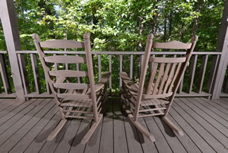 Pigeon Forge Cabin Rental with Outdoor Rocking Chairs to Enjoy the Scenic Wooded View