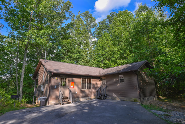 Pigeon Forge Two Bedroom Cabin Rental with a Hot Tub and Area Resort Amenities like hiking and stocked fishing pond
