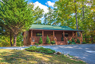 Pigeon Forge Secluded Two Bedroom Cabin Rental that features a Hot Tub, Mountain View, and Foosball Table