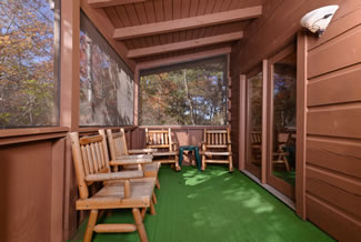 Tennessee Vacation Cabin Rental Screened in Porch with Rocking Sitting Chairs