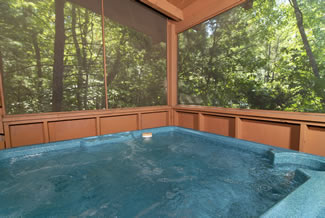 Tennessee Vacation Cabin Rental Outdoor Hot Tub in the Screened in Porch Area