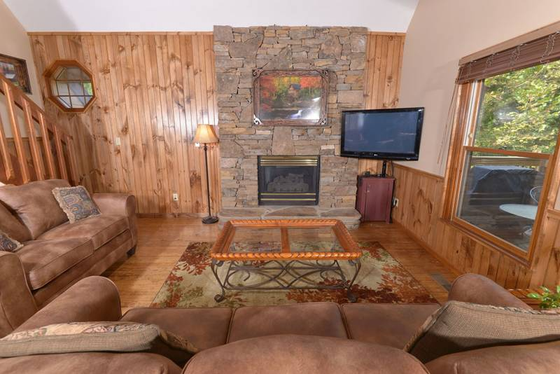 Pigeon Forge TN Cabin with a gas fireplace and a flat screen television