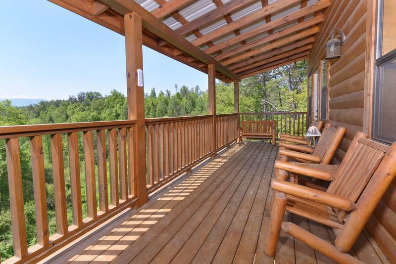Relaxing Pigeon Forge Cabin Outdoor Covered Seating Area