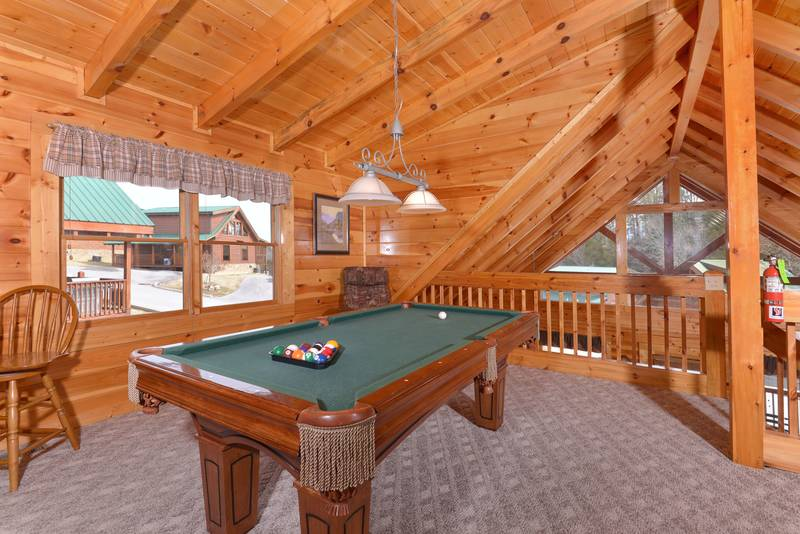 Pigeon Forge Cabin Rental featuring a Pool Table in the Loft Area