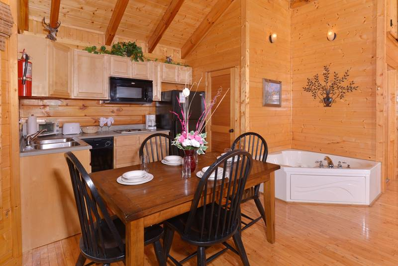 Pigeon Forge Cabin Rental that features a Whirl Pool in the Master Suite